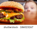hungry boy is staring and... | Shutterstock . vector #186023267