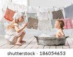 skinny little girl in a basin...   Shutterstock . vector #186054653