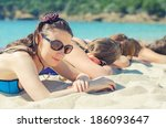 company of girls sunbathing on... | Shutterstock . vector #186093647