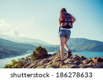 young tourist woman is hiking... | Shutterstock . vector #186278633