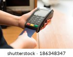 woman pay by credit card in shop | Shutterstock . vector #186348347