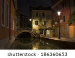 nightshot of a canal in venice | Shutterstock . vector #186360653