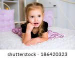 cute little kid in dress on the ... | Shutterstock . vector #186420323