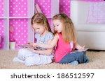sisters  using modern tablet... | Shutterstock . vector #186512597