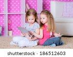 sisters  using modern tablet... | Shutterstock . vector #186512603