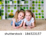 two lovely little girls playing ... | Shutterstock . vector #186523157