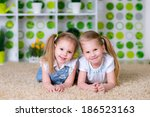 two lovely little sisters... | Shutterstock . vector #186523163