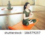 young woman doing yoga   Shutterstock . vector #186579257