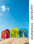 row of colorful flip flops on... | Shutterstock . vector #186781997