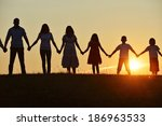 people silhouettes on sunset... | Shutterstock . vector #186963533