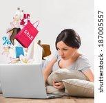 woman shopping online using her ... | Shutterstock . vector #187005557