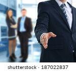 a business man with an open... | Shutterstock . vector #187022837