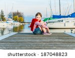 cute little girl resting on a... | Shutterstock . vector #187048823