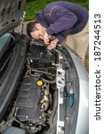 driver is trying to repair car... | Shutterstock . vector #187244513
