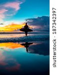 young surfer with board on the... | Shutterstock . vector #187342397