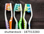 colorful toothbrushes on black... | Shutterstock . vector #187513283