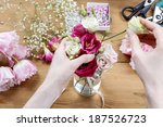 woman making floral wedding... | Shutterstock . vector #187526723
