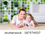 happy smiling family of mother... | Shutterstock . vector #187574537