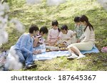 family having flower viewing... | Shutterstock . vector #187645367