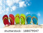 Row Of Colorful Flip Flops On...