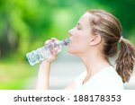 young beautiful woman drinking... | Shutterstock . vector #188178353
