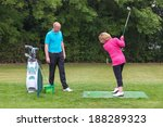 a lady golfer being taught to... | Shutterstock . vector #188289323