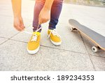 young woman skateboarder tying... | Shutterstock . vector #189234353