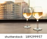 Glasses Of Wine With City View.