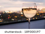 Glass Of White Wine With City...