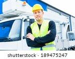 builder or driver standing in...   Shutterstock . vector #189475247