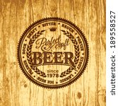 Retro styled label of pub or craft brewery beer scorched on wood