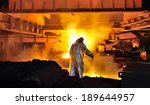 Worker With Hot Steel In Plant