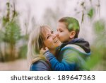 son is kissing his mother... | Shutterstock . vector #189647363