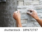 Worker Install Stone Wall...