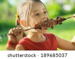 little girl with pleasure eats... | Shutterstock . vector #189685037