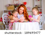 happy mother with children... | Shutterstock . vector #189695477
