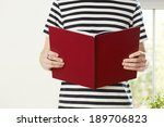 male hands holding book with... | Shutterstock . vector #189706823