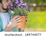 Young Male Gardener Holding A...
