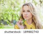 beautiful girl in spring cherry ...   Shutterstock . vector #189882743