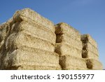 Straw Bales Stacked With Blue...
