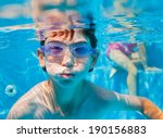 the cute boy swimming... | Shutterstock . vector #190156883