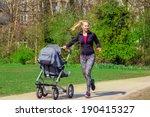 smiling young woman pushing... | Shutterstock . vector #190415327