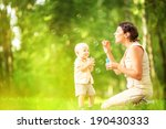 mother and baby blowing bubbles ... | Shutterstock . vector #190430333