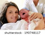 happy mother holding her baby ...   Shutterstock . vector #190748117