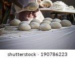 baker making artisan bread in a ... | Shutterstock . vector #190786223