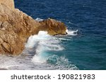 Waves Hitting The Rocky Shore