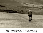 man cycling on sussex downs | Shutterstock . vector #1909685