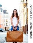 Sad Looking Girl With Luggage....