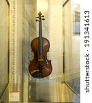 "Small photo of CREMONA, ITALY-JANUARY 13, 2012: The ""Stauffer"" violin made in 1615 by Antonio and Gerolamo Amati, exposed on the world most famous collection of string instruments, at the city hall, in Cremona."