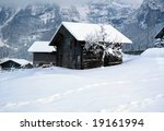 An old cottage in the Swiss Alps. - stock photo